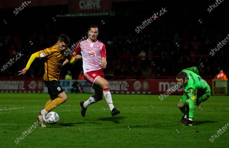 Owen Dale of Crewe Alexandra takes the ball around Ben Nugent and Paul Farman goalkeeper of Stevenage