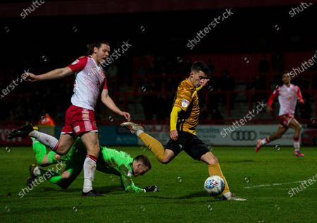 Owen Dale of Crewe Alexandra takes the ball around Ben Nugent and Paul Farman goalkeeper of Stevenage and has a shot at goal