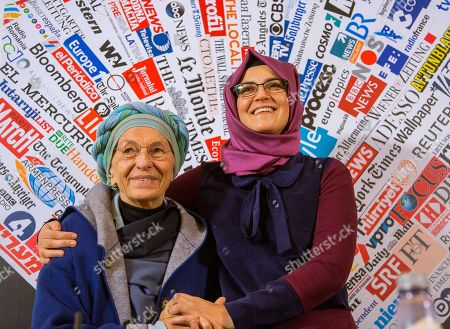 Hatice Cengiz, 37, fiancee of late journalist Jamal Khashoggi who was kidnapped and killed during a visit to the Arabian consulate in Istanbul on Oct. 2018, and Italian Senator Emma Bonino, left, pose for photographers prior to a press conference at the Foreign Press Association in Rome
