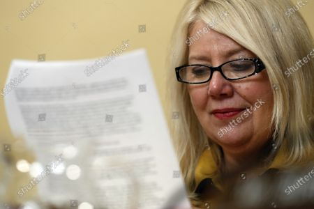 Rep. Debbie Lesko, R-Ariz., reads during a House Rules Committee hearing on the impeachment against US President Donald J. Trump, on Capitol Hill in Washington, DC, USA, 17 December 2019.