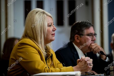 Representative Debbie Lesko (L) listens during a House Rules Committee hearing on the impeachment against US President Donald J. Trump, on Capitol Hill in Washington, DC, USA, 17 December 2019.