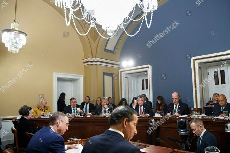 Stock Image of Debbie Lesko, Michael Burgess, Rob Woodall, Tom Cole, Jim McGovern, Alcee Hastings, Doug Collins, Jamie Raskin. House Rules Committee members on dais from left, Rep. Debbie Lesko, R-Ariz., Rep. Michael Burgess, R-Texas, Rep. Rob Woodall, R-Ga., ranking member Rep. Tom Cole, R-Okla., Chairman Rep. Jim McGovern, D-Mass., and Rep. Alcee Hastings, D-Fla., attend the hearing as witnesses House Judiciary Committee ranking member Rep. Doug Collins, R-Ga., front left, and Rep. Jamie Raskin, D-Md., listen during a House Rules Committee hearing on the impeachment against President Donald Trump, on Capitol Hill in Washington
