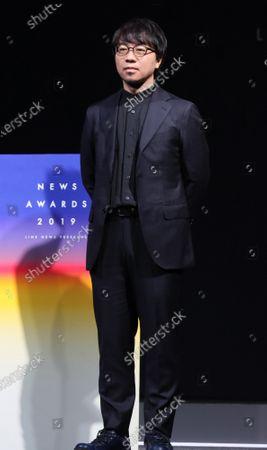 Japanese animation movie director Makoto Shinkai poses for photo at the awarding ceremony.