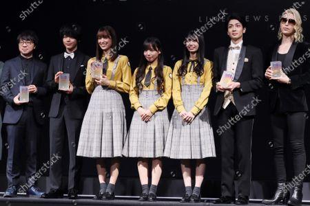 Japanese animation movie director Makoto Shinkai, actor Tomoya Nakamura, Hinatazaka 46 members Kumi Sasaki, Kyoko Saito, Ayaka Takamoto, comedian Yumeya Masaru and host club owner Roland pose for photo at the awarding ceremony.