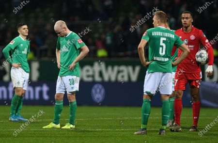 Milot Rashica (L), Davy Klaassen (C) and Ludwig Augustinsson (2-R) of Bremen react after the German Bundesliga soccer match between SV Werder Bremen and 1. FSV Mainz 05 in Bremen, Germany, 17 December 2019.