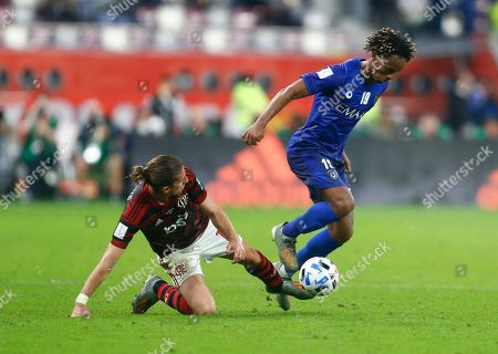 Flamengo's Filipe Luis, left, and Al Hilal's Andre Carrillo fight for the ball during the Club World Cup semifinal soccer match between Flamengo and Al Hilal at the Khalifa International Stadium in Doha, Qatar