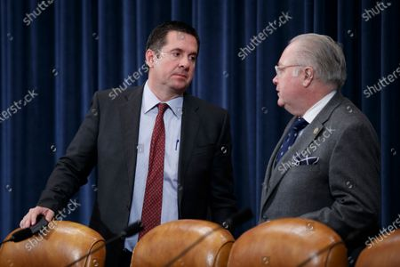 Republican Representative from California Devin Nunes (L) and Republican Representative from North Carolina George Holding (R) talk prior to the House Ways and Means Committee committee markup of H.R.5430, to implement the USMCA on Capitol Hill in Washington, DC, USA, 17 December 2019. A day earlier, the United States and Mexico agreed on a labor rights issue that had threatened to block the progress of the agreement this week.