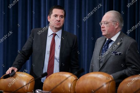Stock Image of Republican Representative from California Devin Nunes (L) and Republican Representative from North Carolina George Holding (R) talk prior to the House Ways and Means Committee committee markup of H.R.5430, to implement the USMCA on Capitol Hill in Washington, DC, USA, 17 December 2019. A day earlier, the United States and Mexico agreed on a labor rights issue that had threatened to block the progress of the agreement this week.