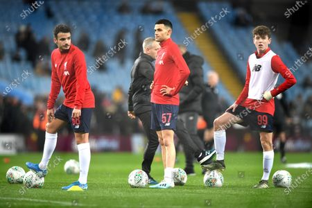 (L-R) Liverpool's Pedro Chirivella, Isaac Christie-Davies and Thomas Hill warm up ahead of the English Carabao Cup quarter-final soccer match between Aston Villa and Liverpool at Villa Park in Brimingham, Britain, 17 December 2019.