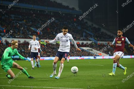 Caoimhin Kelleher of Liverpool (62) and Isaac Christie-Davies of Liverpool (57) stop Neil Taylor of Aston Villa (3) during the EFL Cup match between Aston Villa and Liverpool at Villa Park, Birmingham