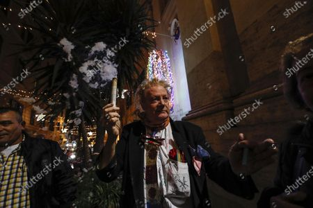 Stock Picture of Artist and architect Cesare Esposito in front of the church of St Lucia during 'the miracle of the snow' his tribute to Pope Francis who celebrates his 83rd birthday, Rome, Italy, 17 December 2019.