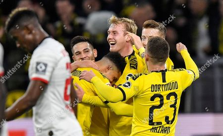 Dortmund's Julian Brandt, center, is celebrated after he scored his side's second goal during the German Bundesliga soccer match between Borussia Dortmund and RB Leipzig in Dortmund, Germany
