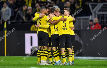 Dortmund's Julian Brandt, center, is celebrated by his team after he scored his side's second goal during the German Bundesliga soccer match between Borussia Dortmund and RB Leipzig in Dortmund, Germany