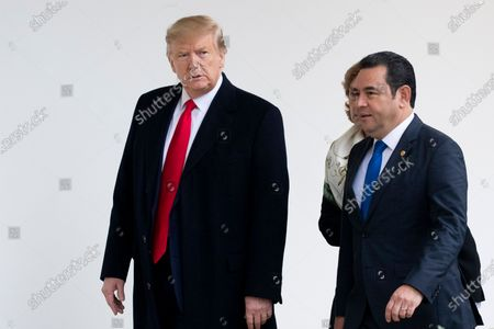 US President Donald Trump (L) and President of Guatemala Jimmy Morales (R) walk down the Colonnade to hold a meeting in the Oval Office at the White House, in Washington, DC, USA, 17 December 2019. The two leaders are expected to discuss immigration, as curbing undocumented migration has been a main priority of the Trump administration.