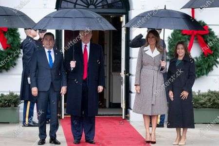 US President Donald Trump (2-L) and First Lady Melania Trump (2-R) greet President of Guatemala Jimmy Morales (L) and his wife Marroquin Argueta de Morales (R) at the South Portico of the White House, in Washington, DC, USA, 17 December 2019. The two leaders are expected to discuss immigration, as curbing undocumented migration has been a main priority of the Trump administration.