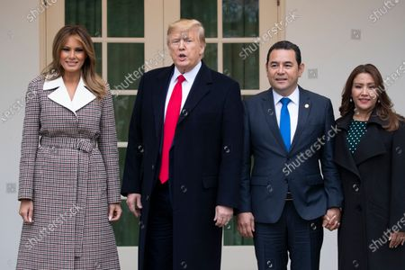 Stock Photo of US President Donald Trump (2-L), First Lady Melania Trump (L), President of Guatemala Jimmy Morales (2-R) and his wife Marroquin Argueta de Morales (R) stand outside the West Wing of the White House before holding a meeting together in the Oval Office, in Washington, DC, USA, 17 December 2019. The two leaders are expected to discuss immigration, as curbing undocumented migration has been a main priority of the Trump administration.