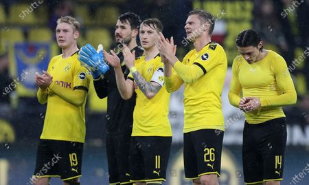 Stock Picture of (L-R) Dortmund's Julian Brandt, goalkeeper Roman Buerki, Marco Reus, Lukasz Piszczek and Nico Schulz react after the German Bundesliga soccer match between Borussia Dortmund and RB Leipzig in Dortmund, Germany, 17 December 2019.