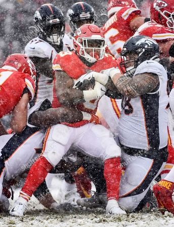 Kansas City Chiefs running back Spencer Ware (39) carries the ball against the Denver Broncos during the second half of an NFL football game in Kansas City, Mo