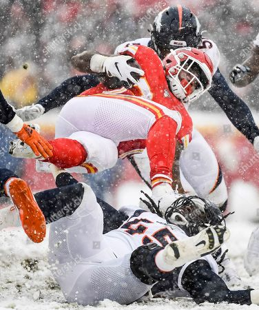 Spencer Ware, A.J. Johnson. Kansas City Chiefs running back Spencer Ware (39) is tackled by Denver Broncos linebacker A.J. Johnson (45) during the second half of an NFL football game in Kansas City, Mo