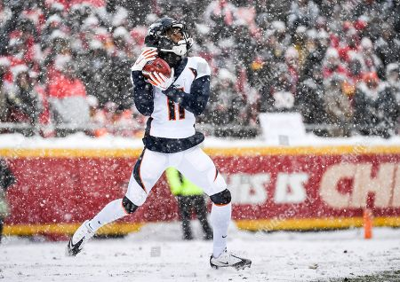 Denver Broncos wide receiver Diontae Spencer (11) takes a kick-off against the Kansas City Chiefs during the second half of an NFL football game in Kansas City, Mo
