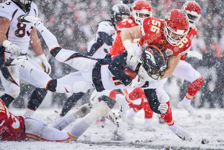 Diontae Spencer, Ben Niemann. Denver Broncos wide receiver Diontae Spencer (11) is tackled by Kansas City Chiefs linebacker Ben Niemann (56) a kick-off against the Kansas City Chiefs during second half of an NFL football game in Kansas City, Mo