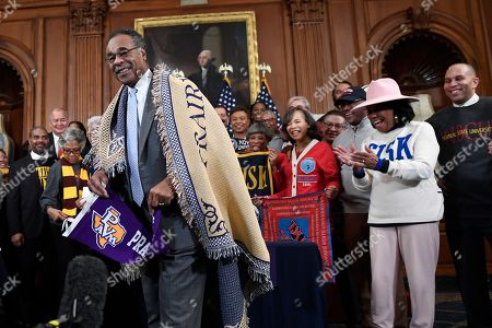 Rep. Emanuel Cleaver, D-Mo., shows off a blanket before the signing of signing H.R. 5363, the Fostering Undergraduate Talent by Unlocking Resources for Education (FUTURE) Act, on Capitol Hill in Washington, . The bipartisan legislation permanently reauthorizes more than $250 million in funding for historically black colleges (HBCUs) and other minority-serving institutions