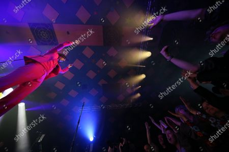 Stock Picture of Primal Scream - Bobby Gillespie and concert-goers