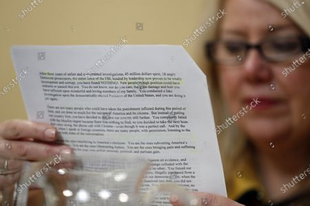 United States Representative Debbie Lesko (Republican of Arizona), reads a copy of the letter US President Donald Trump sent to Speaker of the US House of Representatives Nancy Pelosi (Democrat of California), during a US House Rules Committee hearing on the impeachment on Capital Hill