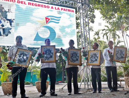 (L-R), Rene Gonzalez, Ramon Labañino, Antonio Guerrero, Fernando Gonzalez and Gerardo Hernandez, five Cubans who served sentences in the United States accused of espionage, show recognition given by the Cuban Institute of Friendship with the Peoples (ICAP) during the act for the 5th Anniversary of their release and return to the island in Havana, Cuba, 17 December 2019.