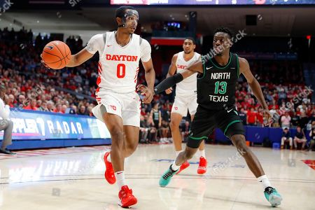 Rodney Chatman, Thomas Bell. Dayton's Rodney Chatman (0) looks to pass against North Texas' Thomas Bell (13) during the second half of an NCAA college basketball game, in Dayton, Ohio