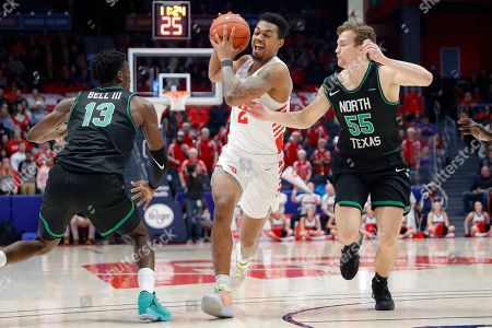 Ibi Watson, DJ Draper, Thomas Bell. Dayton's Ibi Watson (2) drives against North Texas' DJ Draper (55) and Thomas Bell (13) during the second half of an NCAA college basketball game, in Dayton, Ohio