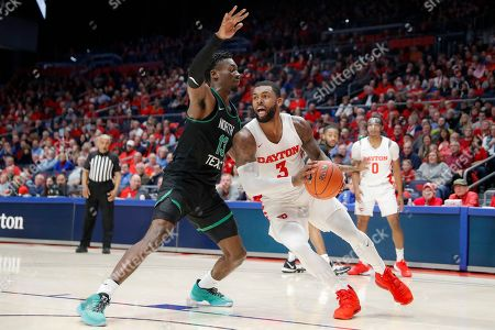 Trey Landers, Thomas Bell. Dayton's Trey Landers (3) drives against North Texas' Thomas Bell (13) during the second half of an NCAA college basketball game, in Dayton, Ohio