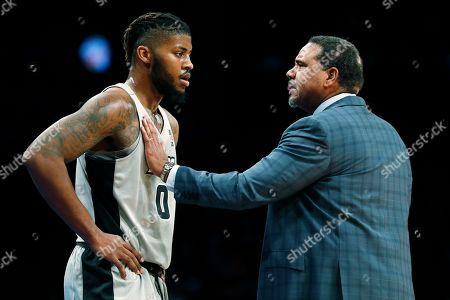 Providence head coach Ed Cooley talks with center Nate Watson (0) during the first half of an NCAA college basketball game against Florida at Barclays Center, in New York