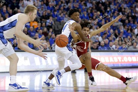 Shereef Mitchell, Jalen Hill, Kelvin Jones. Oklahoma's Jalen Hill (1) loses the ball to Creighton's Kelvin Jones, left, while defended by Shereef Mitchell (4), during the first half of an NCAA college basketball game in Omaha, Neb