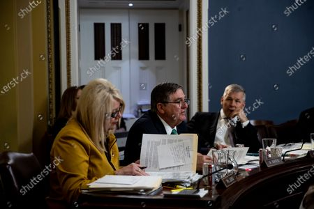United States Representative Michael Burgess (Republican of Texas), center, listens, At left is US Representative Debbie Lesko (Republican of Arizona) to consider H. Res. 755 'Impeaching Donald John Trump, President of the United States, for high crimes and misdemeanors'