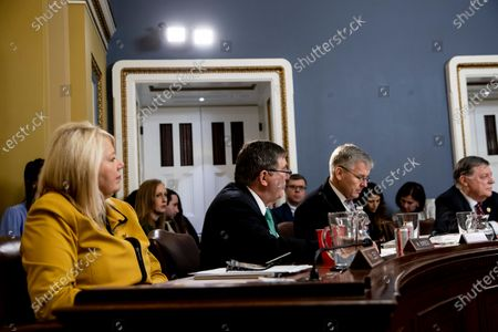 Stock Photo of United States Representative Michael Burgess (Republican of Texas), center, speaks, At left is US Representative Debbie Lesko (Republican of Arizona). to consider H. Res. 755 'Impeaching Donald John Trump, President of the United States, for high crimes and misdemeanors'