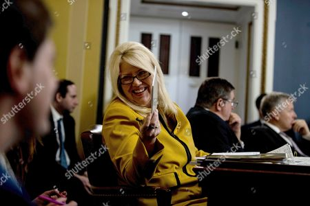 United States Representative Debbie Lesko (Republican of Arizona) speaks to her staff during a US House Committee on Rules hearing.