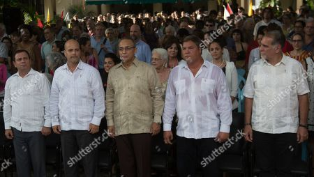 Fernando Gonzalez, left, Gerardo Hernandez, second left, Antonio Guerrero, center, Ramon Labanini, second right and Rene Gonzalez, of those, three of them convicted and sentenced in the United States for spying for Cuba, present themselves at an event, five years after being released, in Havana, Cuba, . The men served 16 years in prison in the United States before being released back to Cuba in a spy swap