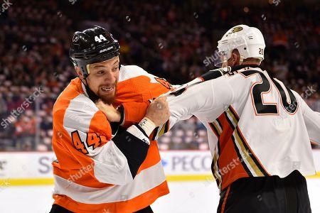 Philadelphia Flyers' Chris Stewart (44) fights Anaheim Ducks' Nicolas Deslauriers (20) during the first period of an NHL hockey game, in Philadelphia