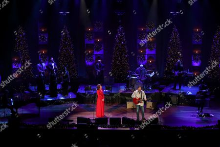 Amy Grant, Vince Gill. Amy Grant, left, and Vince Gill perform at Christmas at the Ryman at Ryman Auditorium,, in Nashville, Tenn