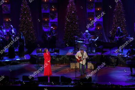 Stock Picture of Amy Grant, Vince Gill. Amy Grant, left, and Vince Gill perform at Christmas at the Ryman at Ryman Auditorium,, in Nashville, Tenn