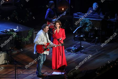 Stock Photo of Amy Grant, Vince Gill. Vince Gill, left, and Amy Grant perform at Christmas at the Ryman at Ryman Auditorium,, in Nashville, Tenn