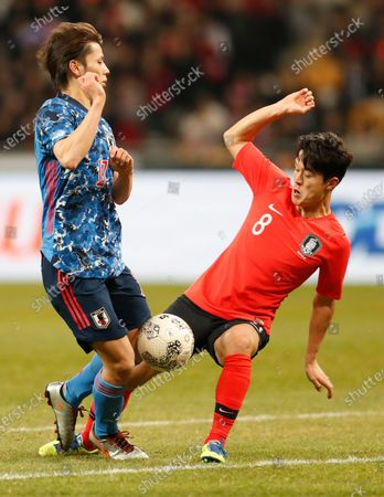 Ao Tanaka (L) of Japan in action against Ju Se-jong (R) of South Korea during the EAFF E-1 Football Championship men's soccer tournament match between South Korea and Japan at the Busan Asiad Main Stadium in Busan, South Korea, 18 December 2019.