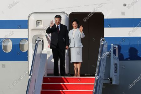 Chinese President Xi Jinping (L) is accompanied by his wife Peng Liyuan (R) as they arrive at Macao International Airport in Macao, China, 18 December 2019. President Xi is in Macao to participate in the Macao Special Administrative Region of the People's Republic of China 20th anniversary celebrations. Macao was governed by Portugal until 1999 when it was transferred to China. As a special administrative region, Macao maintains separate governing and economic systems from that of mainland China.
