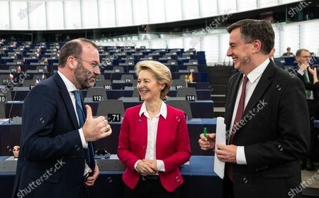 (L-R) Chairman of the EPP Group in the European Parliament Manfred Weber speaks with European Commission President Ursula von der Leyen and David McAllister, Member of Parliament from the EPP Group, before a debate at the European Parliament in Strasbourg, France, 18 December 2019. The European Parliament is in plenary session from 16 to 19 December 2019.