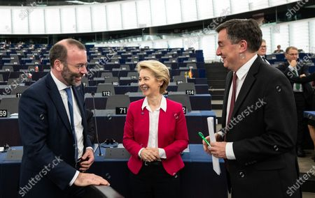 Chairman of the EPP Group in the European Parliament Manfred Weber  speaks with European Commission President Ursula von der Leyen and David McAllister, Member of Parliament from the EPP Group (L-R)  before a debate at the European Parliament in Strasbourg, France, 18 December 2019. The European Parliament is in plenary session from 16 to 19 December 2019.