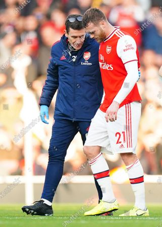 Calum Chambers of Arsenal goes off injured