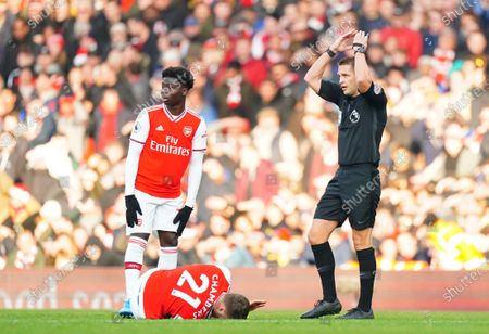 Calum Chambers of Arsenal goes down injured and is forced off