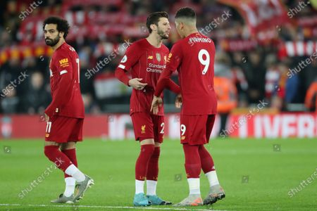 Mohamed Salah, Adam Lallana and Roberto Firmino of Liverpool before kick-off