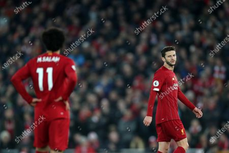 Adam Lallana of Liverpool speaks with Mohamed Salah